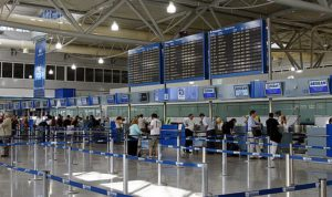 800px-Athens_International_Airport_check_in_desks
